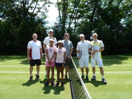 Grass Court Tennis - Doubles Players - Umpire and Ball Girls